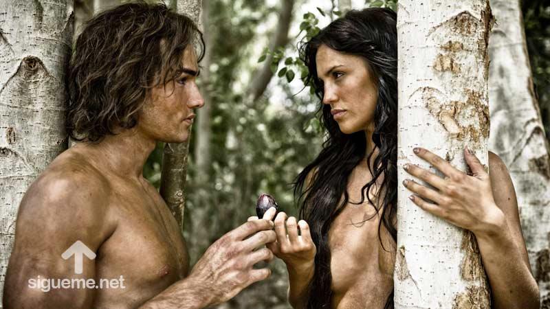 Adan y Eva en el huerto del Eden comiendo del fruto prohibido
