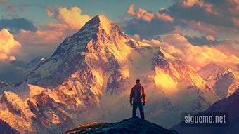 Un hombre de fe en la cima de una montaña